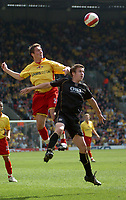 Photo: Tony Oudot.<br />Watford v Portsmouth. The Barclays Premiership. 09/04/2007.<br />Tommy Smith of Watford wins a header from Sean Davis of Portsmouth