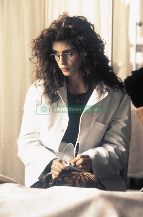 RELEASE DATE: August 10, 1990 <br /> MOVIE TITLE: Flatliners <br /> STUDIO: Columbia Pictures <br /> DIRECTOR: Joel Schumacher <br /> PLOT: Medical students bring themselves near death; their experiment begins to go awry.<br /> PICTURED: JULIA ROBERTS as Dr. Rachel Mannus. <br /> (Credit Image: © Columbia Pictures/Entertainment Pictures/ZUMAPRESS.com)