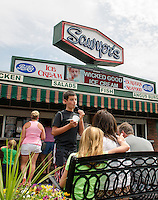 Adam Rubin cools off with a cup of cookie dough ice cream with Jill, Brenda and Larry Rubin sitting outside at Sawyers Dairy Bar Thursday afternoon.  (Karen Bobotas/for the Laconia Daily Sun)