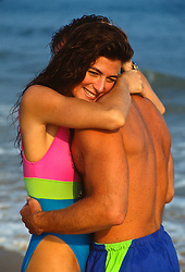 Couple embracing at the beach in East Hampton, NY