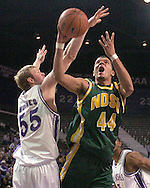 North Dakota State forward Andre Smith (44) drives and scores past Kansas State's Tyler Hughes (55) in the first half, during K-State's 82-56 win over North Dakota State at Bramlage Coliseum in Manhattan, Kansas, January 2, 2006.