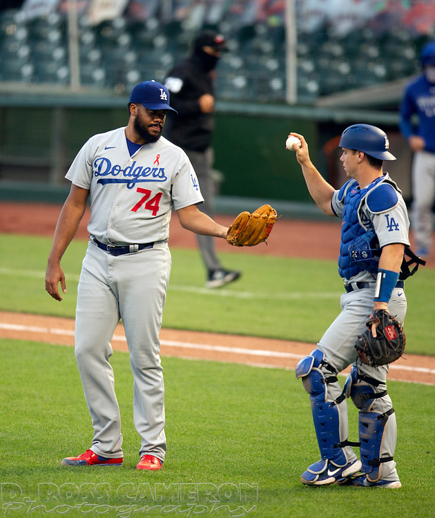 Los Angeles Dodgers pitcher Kenley Jansen (74) and catcher Will Smith celebrate their sweep of the San Francisco Giants following the second baseball game of a doubleheader on Thursday, Aug. 27, 2020 in San Francisco, Calif. (D. Ross Cameron/SF Chronicle)