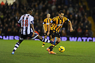 Hull city's Jake Livermore ® goes past West Brom's Saido Berahino.  Barclays Premier league, West Bromwich Albion v Hull city at the Hawthorns in West Bromwich, England on Saturday 21st Dec 2013. pic by Andrew Orchard, Andrew Orchard sports photography.