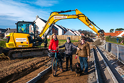 East Lothian Core Paths, Gullane, East Lothian, Scotland, United Kingdom, 07 February 2020. Construction has started on a pedestrian and cycle path to connect Gullane and West Fenton villages. The longest running campaign of its kind in Scotland, activists have lobbied for 15 years for an off-road route, away from a dangerous main road, to link Gullane and Drem. After reaching agreement with landowners, housing company CALA Homes is funding a one mile section of the path between Gullane and West Fenton. Pictured (L t R): Clare Cavers, local cyclist, Rowan McLaughlin, aged 10 years & Jackie Buchan with Jess, local residents.<br /> Sally Anderson | EdinburghElitemedia.co.uk