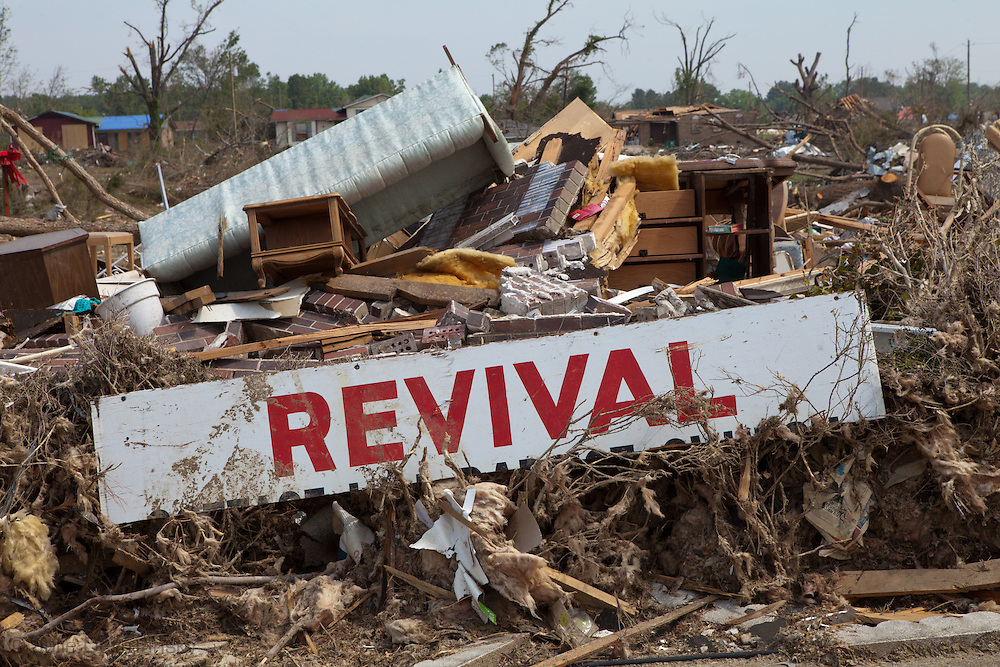 A sign for revival in front of rubble left in the wake of a series of tornados that hit Alalbama. Pleasant Grove, a suburb of Birmingham, Alabama .Pleasant Grove remains in a state of ruin over two weeks after it was hit by an F-4 ( possibly an F-5) tornado, one of an estimated 300 that struck Alabama and the neighboring states on April 27th .