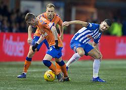 Kilmarnock's Jordon Jones (right) and Rangers' Ryan Kent (left) battle for the ball during the Ladbrokes Scottish Premiership match at Rugby Park, Kilmarnock.