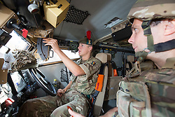 Morgan Davies with Matt in the front seat in of one of the Foxhounds. Feature on the Army's new Foxhound light mechanised infantry vehicles at Fort George army barracks, before they leave on convoy for England, before going into active service.