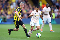 Watford's Will Hughes (left) and Manchester United's Alexis Sanchez battle for the ball during the Premier League match at Vicarage Road, Watford