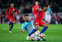 Bostjan Cesar of Slovenia vs Theo Walcott of England during football match between National teams of Slovenia and England in Round #3 of FIFA World Cup Russia 2018 Qualifier Group F, on October 11, 2016 in SRC Stozice, Ljubljana, Slovenia. Photo by Vid Ponikvar / Sportida