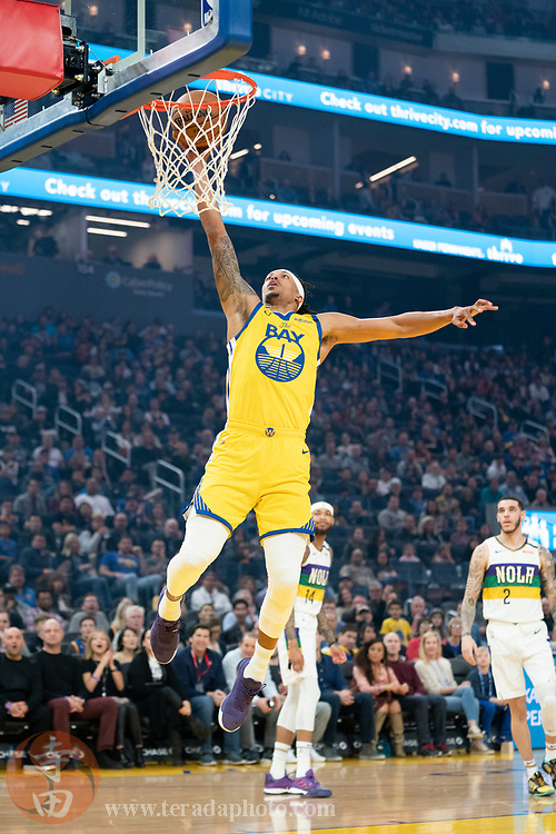 February 23, 2020; San Francisco, California, USA; Golden State Warriors guard Damion Lee (1) dunks the basketball during the first quarter against the New Orleans Pelicans at Chase Center.