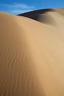 Sahara desert sand dunes with blue sky at Erg Chebbi, Merzouga, Morocco.