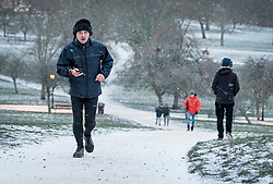 © Licensed to London News Pictures. 09/02/2021. London, UK. A jogger braves the freezing conditions in the early morning on Primrose Hill in Camden, North London as snow continues to fall in the capital. Strong easterly winds from Ukraine and the Black Sea are expected to last in to the middle of the week. Photo credit: Ben Cawthra/LNP