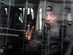 © Licensed to London News Pictures. 11/11/2011. London, UK. An arrested man sits in a police van and gives a victory sign with his hand. Police arrest members of the EDL near the Cenotaph following a Remembrance Day service today (11/11/2011). A large group of EDL members where arrested. Police a. Photo credit : Stephen Simpson/LNP