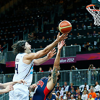 06 August 2012: Argentina Luis Scola goes for the layup over Deron Williams during 126-97 Team USA victory over Team Argentina, during the men's basketball preliminary, at the Basketball Arena, in London, Great Britain.