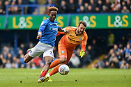 Portsmouth Midfielder, Jamal Lowe (10) rounds Rochdale Goalkeeper, Josh Lillis (1) to score a goal and make it 4-1 during the EFL Sky Bet League 1 match between Portsmouth and Rochdale at Fratton Park, Portsmouth, England on 13 April 2019.