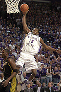 Kansas State forward David Hoskins (15) drives and scores on a fast brake over Missouri's Jimmy McKinney (1) during the second half of K-State's 79-64 win over the Tigers at Bramlage Coliseum in Manhattan, Kansas, January 21, 2006.