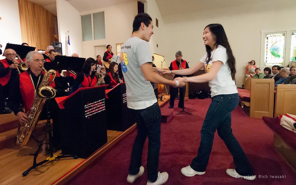 Members of Unite People dance to the music of the Minidoka Swing Band at the 2011 Memorial Tribute to Robbie Tsuboi, Epworth United Methodist Church, Portland, Oregon