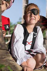 Girl dressed up as a pirate playing with her friends in playground, Bavaria, Germany