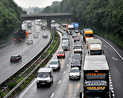 © Licensed to London News Pictures. 06/072012 ,Stoke, Staffordshire, England.Heavy rain, has caused chaos and localised flooding across many part of Staffordshire today. Localised flooding slows down the flow of traffic ,on the M6 north bound    .Photo credit : Rob Leyland/LNP