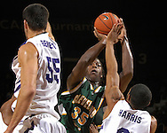 Cleveland State forward J'nathan Bullock (35) drives to the basket against pressure from Kansas State's Lance Harris (3) and Jason Bennett (55) in the first half at Bramlage Coliseum in Manhattan, Kansas, December 5, 2006.<br />