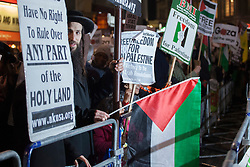 © licensed to London News Pictures. London, UK 15/11/2012. Anti-zionst Jewish protesters join the Islamist protesters outside Israeli Embassy in London as the conflict in Gaza escalates. Photo credit: Tolga Akmen/LNP
