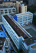 SHAOXING, CHINA - <br /> <br /> Rooftops With A Wide Variety Of Uses Around China<br /> <br /> After the story from China Last week on A Chinese man has spent six years building his dream mountaintop villa - on top of a Beijing apartment block.  we show how you can get away with making the most of your roof top with these legal designs...<br /> <br /> Students do exercise during a PE class at a rooftop playground at Dongwan Primary School  in Shenzhen, Guangdong Province of China.<br /> ©Exclusivepix