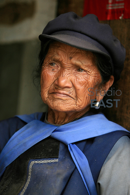 YUNNAN PROVINCE, CHINA - May 01: An old woman belonging to the Naxi minority on May 1, 2007 near Lijiang, Yunnan province, China. (Photo by Lucas Schifres/Getty Images)