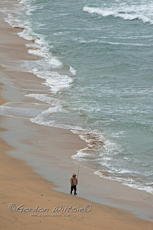 A fisherman on Montara State Beach south of San Francisco, California.