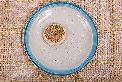 13 January 2012:   fresh baked sprinkled sugar cookies displayed on a stoneware platter
