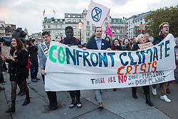 London, UK. 17 October, 2019. Climate activists from Extinction Rebellion prepare to defy the Metropolitan Police ban on Autumn Uprising protests under Section 14 of the Public Order Act 1986 by attending an XR Professionals assembly in Trafalgar Square. Activists addressed the assembly about the impact of climate change on their work.