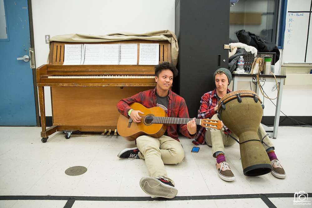Vincent Academia and Max Huss, right, rehearse backstage before performing at the Milpitas High School Talent Show at Milpitas High School in Milpitas, California, on February 5, 2016. (Stan Olszewski/SOSKIphoto)