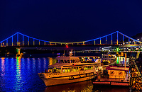 Kiev , Ukraine - August 31, 2019 : Parkovyi Bridge on Dniepr river port waterfront with cruise boats Landmark of Kiev Ukraine Europe