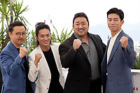 Director Lee Won-tae, with actors Kim Sung-Kyu, Lee Don and Kim Moo-Yul at The Gangster, The Cop, The Devil film photo call at the 72nd Cannes Film Festival, Thursday 23rd May 2019, Cannes, France. Photo credit: Doreen Kennedy