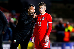 Wales head coach Ryan Giggs speaks to Declan John of Wales - Mandatory by-line: Robbie Stephenson/JMP - 20/03/2019 - FOOTBALL - The Racecourse Ground - Wrexham, United Kingdom - Wales v Trinidad and Tobago - International Challenge Match