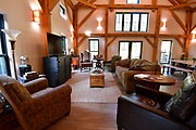 Plenty of seating in the main living area on the first floor of the home of Steve and Jennifer Schatz of rural Pacific. The open-concept home is designed to resemble a Missouri dairy barn. <br /> Photo by Tim Vizer
