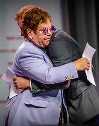Prince Harry, Duke of Sussex hugs Sir Elton John at a plenary session to launch a new coalition of global Aids funders the MenStar Coalition during the Aids 2018 summit in Amsterdam, the Netherlands, Tuesday July 24, 2018. Photo by Robin Utrecht/ABACAPRESS.COM