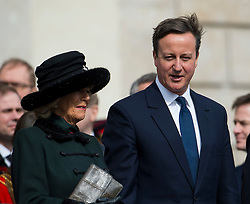 © London News Pictures. 13/03/2015. Camilla, Duchess of Cornwall and British Prime Minister David Cameron attend a service of commemoration to mark the end of combat operations in Afghanistan, at St Paul's Cathedral in London. Photo credit: Ben Cawthra/LNP