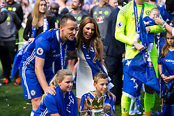 Retiring captain John Terry and his family pose with the trophy as Chelsea celebrate winning the 2016/17 Premier League - Rogan Thomson/JMP - 21/05/2017 - FOOTBALL - Stamford Bridge - London, England - Chelsea v Sunderland - Premier League..