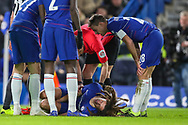 Chelsea midfielder Ethan Ampadu (44) is tended to after a collision with Sheffield Wednesday midfielder Joey Pelupessy (8) (not in the picture) during the The FA Cup fourth round match between Chelsea and Sheffield Wednesday at Stamford Bridge, London, England on 27 January 2019.