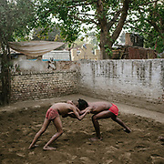 A school for learning Kushti (an ancient sport similar to wrestling) nearby the Nigambodh Gath, on the banks of the polluted Yamuna.