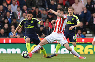 Geoff Cameron of Stoke intercepts Kirean Gibbs of Arsenal. Premier league match, Stoke City v Arsenal at the Bet365 Stadium in Stoke on Trent, Staffs on Saturday 13th May 2017.<br /> pic by Bradley Collyer, Andrew Orchard sports photography.