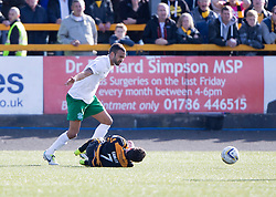 Hibernian's Liam Fontaine brings down Alloa Athletic's Kevin Cawley for the free kick that Alloa Athletic scored the winner from.<br /> Alloa Athletic 2 v 1 Hibernian, Scottish Championship game played 30/8/2014 at Alloa Athletic's home ground, Recreation Park, Alloa.