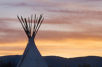 Tepee silhouetted at sunset, Bannack State Park Montana