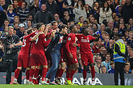 A pitch invader joins Liverpool as they celebrate their goal by Liverpool forward Daniel Sturridge (15) during the Premier League match between Chelsea and Liverpool at Stamford Bridge, London, England on 29 September 2018.