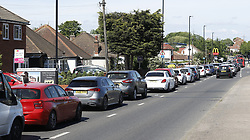 © Licensed to London News Pictures. 20/05/2020. Sutton, UK. Long queues build up at a McDonald's Drive Through restaurant at Sutton, south London. A small number of Drive Through only branches are opening today. The government has announced a series of measures to slowly ease lockdown, which was introduced to fight the spread of the COVID-19 strain of coronavirus. Photo credit: Peter Macdiarmid/LNP