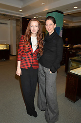 Left to right, OLIVIA GRANT and MARIA GRACHVOGEL at the official opening of the 2014 Tiffany & Co.Christmas Shop on Bond Street, London on 16th November 2014.