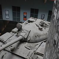 A Russian tank is seen surrounded by victims' faces in Terror House Museum as part of a free exhibition during Hungary's national holiday commemorating the revolution of 1956 in Budapest, Hungary on October 23, 2014. ATTILA VOLGYI