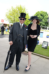 SIR DAVID TANG and ALEXANDRA KARPOVA at the Investec Derby 2013 held at Epsom Racecourse, Epsom, Surrey on 1st June 2013.
