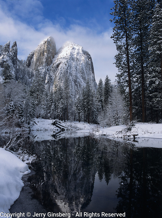 Cathedral Spires reflect in a flooded the Merced River in winter, Yosemite National Park, CA.