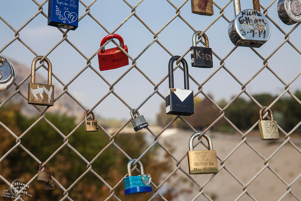 Love Locks adorn the Sunnynook Pedestrian Bridge over the Los Angeles River along the Glendale Narrows